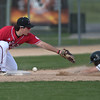 Mankato West's Avery Miller can't come up with the throw to third base to tag out Rochester Mayo's Evan Kaese during Friday's conference game played at Franklin Rogers Park. The Scarlets lost 7-6 and now have an overall record of 5-4. Photo by Jackson Forderer