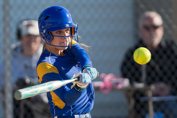 Sarah Haugum of Mankato Loyola takes a swing at a pitch in Tuesday's conference game against Lake Crystal-Wellcome-Memorial. Loyola defeated the Knights 6-1. Photo by Jackson Forderer