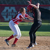 Mankato West's Emily Veroeven puts a tag on Rochester John Marshall's Sam Guetter after a ground ball was hit at Veroeven. Veroeven completed a double play with a throw to first base for a force out. Photo by Jackson Forderer
