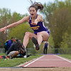 Minnesota State's Rachel Schumacher makes her final leap into the sand pit during the triple jump at the MSU Twilight track meet held on Wednesday. Schumacher finished in second place with a jump of 36 feet 3 inches. Photo by Jackson Forderer