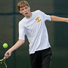 Zach Riel of Mankato East hits a forehand during his match against Mankato West's Aaron Erdman on Thursday. West won the match 6-1. Photo by Jackson Forderer