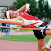 Mankato West's Hannah Fox clears the bar during the high jump Saturday.