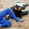 John Cross <br /> Le Sueur's Kelsey Schmidt (left) and Holy Family's Anna Herd get tangled up in a play at first base during 2AA quarterfinal action Saturday.