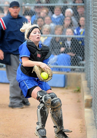 John Cross<br /> Lake Crystal-Wellcome Memorial catcher Lindsey Zeigler snags a foul tip just short of the fence during 2A quarterfinal action with Loyola Saturday.