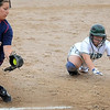 John Cross<br /> Maple River's Kylie Olson will beat the tag from St. Peter's Kasandra McCabe to safely steal third base during 2AA quarterfinal action Saturday at Caswell Park.