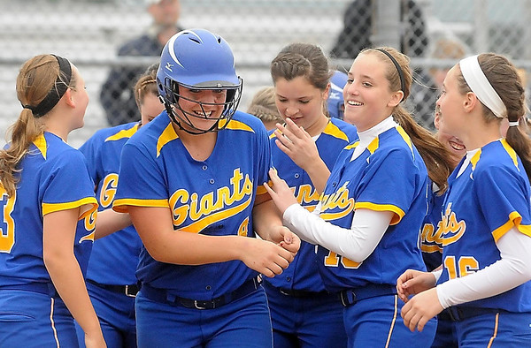 John Cross<br /> Le Sueur's Carlie Brandt is congratulated by teammates after hitting a homerun that proved to be the winning in their 1-0  quarterfinal win against Holy Family Saturday.