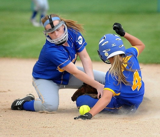 John Cross<br /> Le Sueur's Carlie Brandt safely steals second as Waseca's Samantha Barrie loses the ball in 2AA semifinal action Tuesday at Caswell Park.