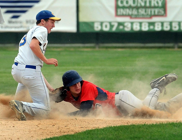 John Cross<br /> United South Central's Kyle Bauman gets beneath the tag of Loyola's Evan Ellingworth to safely steal third in 2A subsection action at Franklin Rogers Park, Monday.