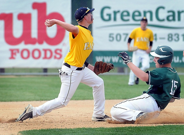 John Cross<br /> Faribault's Evan Jensen is out at second as East's Jordan Grams turns the first half of a first inning double play Monday at Wolverton Field.