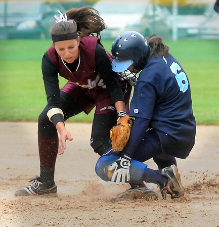 John Cross<br /> New Ulm Cathedral's Lisa Helget puts the tag on MVL's Emily Wessel at second base during 2A quarterfinal action Saturday.