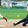 John Cross<br /> Mankato East's Carolyn Osboda safely steals second on a strikeout as Mankato West infielder Kinzie Scearcy chases down the errant throw from home during Section 2AAA action Tuesday at Caswell Park