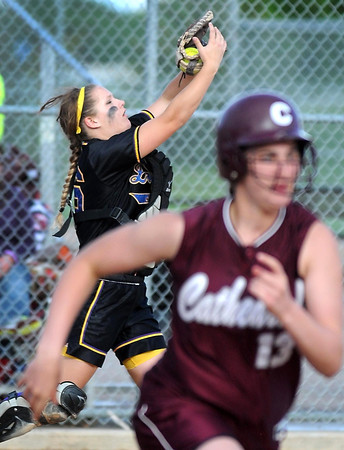 Pat Christman<br /> Mankato Loyola catcher MaKenna Elert brings in a pop up from New Ulm Cathedral's Anne Schwarz (13) during their Section 2A championship game Thursday at Caswell Park.