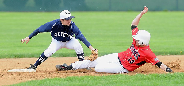John Cross<br /> St. Peter's Cody Erickson puts the tag on NRHEG's Brad Claycomb during an attempted steal early in the game.