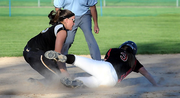 John Cross<br /> Eden Prairie's Madison Whitley gets beneath the tag of East's Savannah Quandt to safely steal second early in their Section AAA game Thursday at Caswell Park.