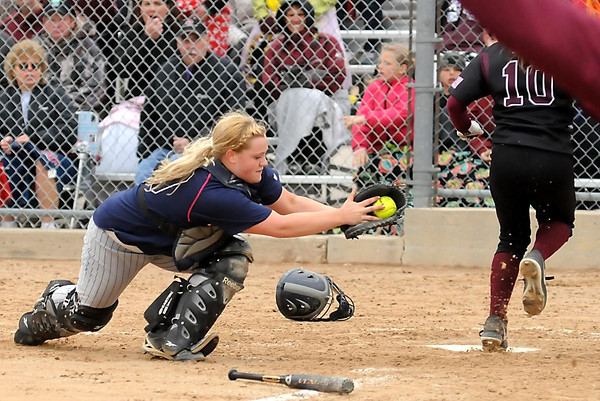 John Cross<br /> St. Peter catcher Kelly Hilligoss can't quite make the tag on Norwood-Young America's Kaylie Brazil as she score's the Raider's lone run during a Section 2AA game Saturday at Caswell Park.