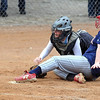 Pat Christman<br /> St. Peter's Carolyn Conlon slides into home as Tri City United's Coley Selley loses the ball during the third inning Tuesday in St. Peter.