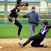John  Cross<br /> Chaska's Kaley DeCou slides safely into second on a wild throw to Mankato East's Savannah Quandt during a Section 2AAA elimination game Saturday at Caswell Park.