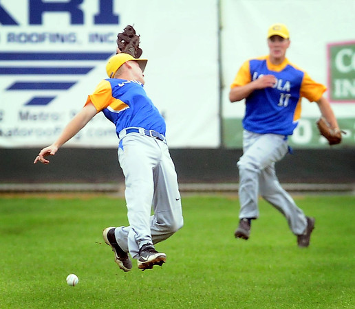 John Cross<br /> Loyola's Blake Matuska can't quite get to a fly ball as Jake Peller rushes in to back him up during the fourth inning of a game against Waterville-Elysian-Morristown Tuesday at Franklin Rogers Park.