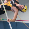 Wyatt Betz of Mankato East clears the bar in the pole vault event during the Section 2AA track meet held at Gustavus on Wednesday. Photo by Jackson Forderer