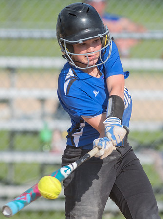 Marah Hulke of Nicollet connects with a ball as the Raiders rallied in the bottom of the sixth inning against Truman/Grenada-Huntley-East Chain/Martin Luther on Tuesday. The Raiders scored seven runs in the inning and won 7-1 to advance in the Section 2A softball tournament. Photo by Jackson Forderer