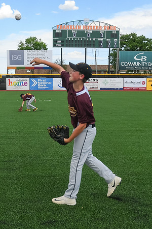 Riston Wojcik with the Royals 13AA Maroon little league team plays catch with a teammate in the new outfield at the grand re-opening of Franklin Rogers Park on Friday. A new scoreboard has also been placed in left field. Photo by Jackson Forderer