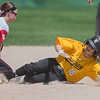 Mankato East's Savanna Witte is tagged out at second base by Mankato West's Jalissa Stoltzman during Saturday's Section 2AAA softball tournament played at Caswell Park. The Scarlets won 11-1 and will face New Ulm on Tuesday. Photo by Jackson Forderer