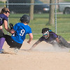 Nicollet's Emily Bode (9) slides safely into third base as Truman/Grenada-Huntley-East Chain/Martin Luther's Lizzie Oothoudt mishandles the ball in the bottom of the sixth inning. The Raiders came back from a 1-0 deficit, scoring seven runs and eventually won 7-1. Photo by Jackson Forderer