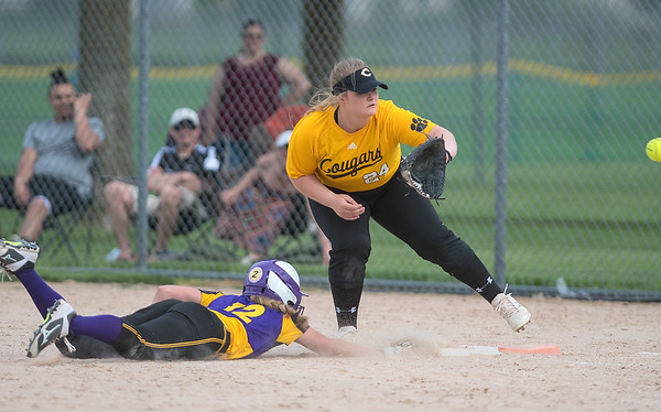 Mankato East's Bri Adams waits for a throw to first in a pick off attempt on Waconia's Claire Segner who slide safely back to the bag. East beat Waconia 3-2 in the first round of the Section 2AAA softball tournament played at Caswell Park on Thursday. Photo by Jackson Forderer