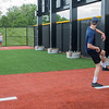 Evan Furst (right) pretends to throw a pitch to Katelyn Furst in the new bullpens at the grand re-opening of the remodeled Franklin Rogers Park on Friday. Photo by Jackson Forderer
