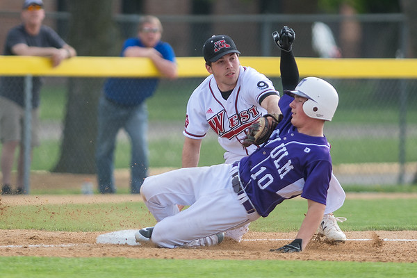 Mankato West's Avery Miller tags out New Ulm's Nolan Drill at third base during Wednesday's game. West won the game in five innings by the score 12-2. Photo by Jackson Forderer