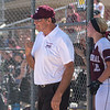 New Ulm Cathedral's head softball coach Bob Mertz pumps his fist coming out of the dugout, celebrating his 800th win after the Greyhounds defeated Sleepy Eye 7-2 in the Section 2A softball tournament. Photo by Jackson Forderer