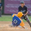 Mankato Loyola's Nick Stoffel (13) successfully steals second base ahead of a tag by Minnesota Valley Lutheran's Derek Weisensel in Thursday's game played at Wolverton Field. Photo by Jackson Forderer