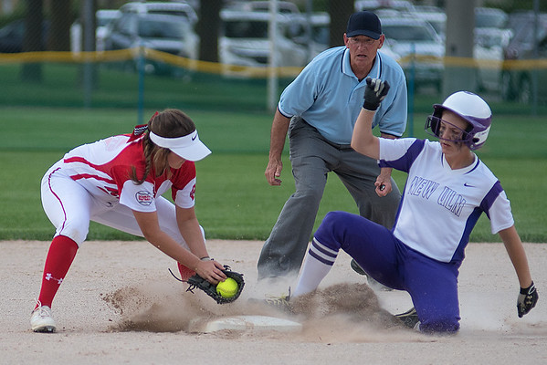 New Ulm's Noelle Forstner slides into second base ahead of a tag applied by Mankato West's Emily Veroeven in the bottom of the first inning. The Eagles edged the Scarlets 3-2 in an eight-inning game. Photo by Jackson Forderer