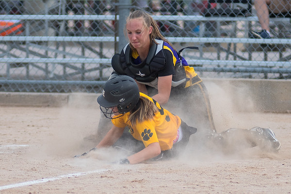 Sabrina Lehne of Mankato East slides into home plate underneath a tag by Waconia catcher Holly Weinberger. The Cougars rallied to bet Waconia 3-2 and faced off against Faribault in the second round of the Section 2AAA softball tournament at Caswell Park. Photo by Jackson Forderer