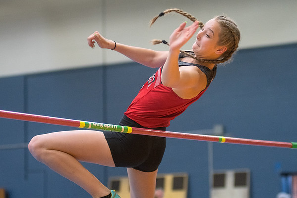 Sydney Voss of Mankato West clears the bar in the high jump event at the Section 2AA track meet held at Gustavus on Wednesday. Photo by Jackson Forderer