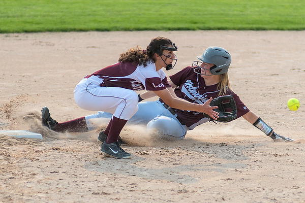 New Ulm Cathedral's Sarah Mohr awaits a throw to second base as Mountain Lake Area's Brooke Naas slides into the bag during Thursday's Section 2A playoff game. Naas was called safe on the play but Cathedral won the game 2-0 to advance to the State Tournament. Photo by Jackson Forderer