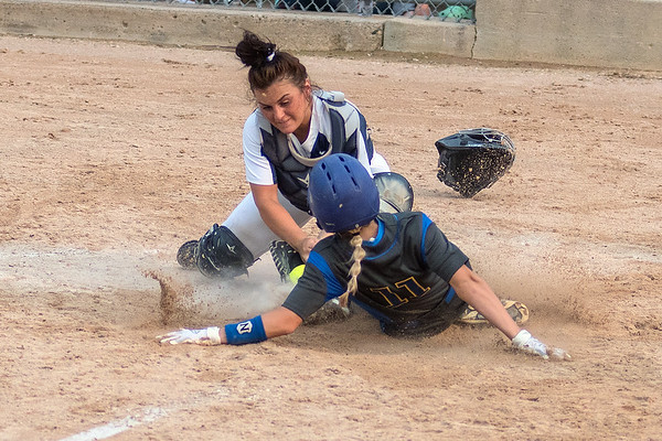 Le Sueur-Henderson's Chloe Brandt slides into home as St. Peter's Allie McCabe tries to apply a tag during a squeeze play by LSH. The Giants won a nail bater 5-4 in 11 innings to advance to the State Tournament. Photo by Jackson Forderer