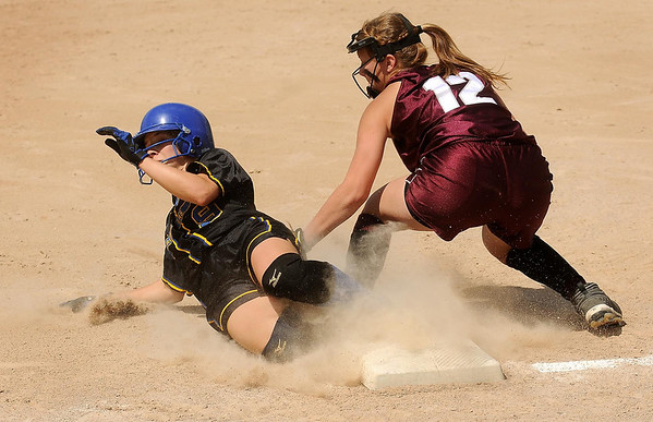 Loyola's Aunikah Bastian beat's the tag by McKenna Berdan to safely reach third during fourth inning action at Caswell Park on Saturday. Photo by John Cross