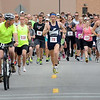 Runners take off from the starting line for the 10Kato Run on Monday. About 325 runners and walkers particapating in the event. Photo by John Cross