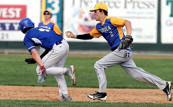 Mankato Loyola's Will Cipos tags out Lake Crystal-Wellcome Memorial's Bryson Yackel during a rundown between second and third during a game Tuesday at Franklin Rogers Park. Photo by Pat Christman