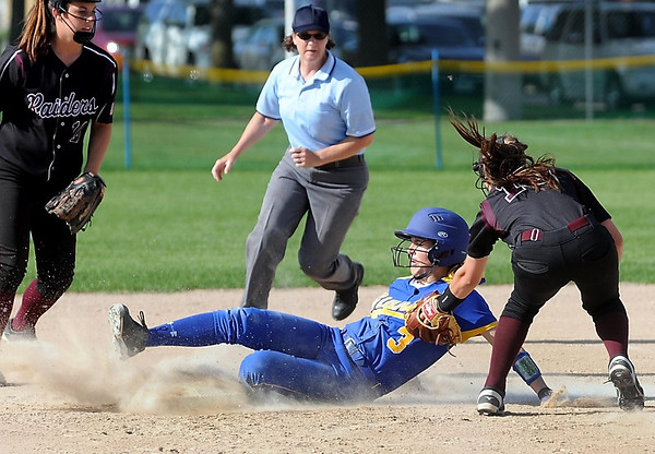 Le Sueur-Henderson's Alicia Boettcher steals second ahead of the tag of Norwood Young America's Kaylie Brazil during the first game of the Section 2A final Thursday at Caswell Park. Photo by Pat Christman