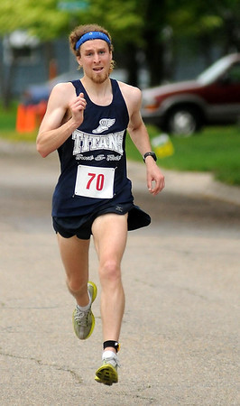 Zane Grabau of Waterville crossed the finish line first for the men with a time of 34:33. Photo by John Cross
