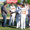 Former Minnesota Twins pitcher Eddie Guardado shakes hands with Mankato MoonDogs players before their home opener Wednesday at Franklin Rogers Park. Photo by Pat Christman