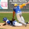 Loyola's Mark Korteum puts the tag on JWP's Alex Kjolstad during fourth inning action at Franklin Rogers Park on Thursday. Photo by John Cross
