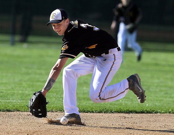 Mankato East shortstop Ryan Carlsten runs down a ground ball during a game against Rochester Mayo Wednesday at Wolverton Field. Photo by Pat Christman