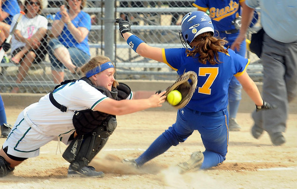 Le Sueur-Henderson's Sammy Winter gets past the tag of Maple River catcher Kylie Olson to score during first inning action at Caswell Park on Saturday. Photo by John Cross