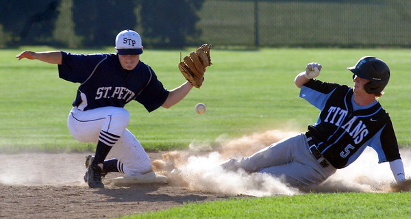 Tri City United's Aaron Dwyer is safe at second on a wild pitch as St. Peter's Ryan Hoehn fields the ball during seventh inning action at Veterans Field in St. Peter on Thursday. Photo by John Cross