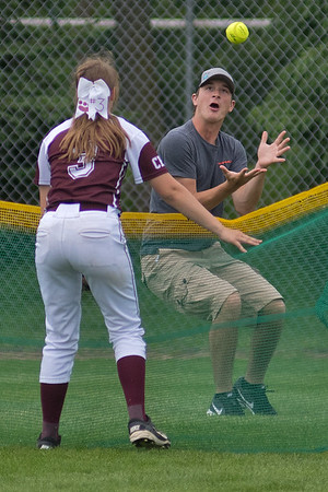 New Ulm Cathedral's Lauryn Franta (3) watches a fan catch a home run ball hit by a Sleepy Eye St. Mary's player in a Section 2A softball playoff game. Cathedral lost to SESM 16-1. Photo by Jackson Forderer