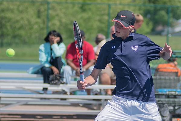 Drew Elofson of St. Peter hits a backhand volley in a doubles match against Rochester Lourdes. Elofson and his doubles partner Rafat Solamain earned a berth in the boys state tennis tournament on Friday. Photo by Jackson Forderer