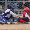 New Ulm catcher Camryn Schiro tags out Jordyn Kuhlmann of Mankato West at home in a Section 2AAA playoff game at Caswell Park on Thursday. Photo by Jackson Forderer
